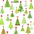 Seamless funny wallpaper with cut out paper abstract green firs with red stars for Christmas greeting design. Flat style