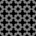 Seamless geometric pattern of circles on a black background.
