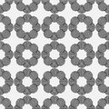 Seamless geometric pattern of circles on a gray background.
