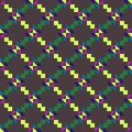 Seamless geometric pattern with colored triangles and squares on grey background.