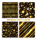 Seamless grunge gold and black colored patterns