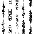 Seamless hand drawn geometric tribal pattern with feathers. Vector navajo design.