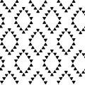 Seamless hand drawn geometric tribal pattern with rhombuses and triangles. Vector navajo design.