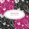 Seamless hand drawn white heart texture on pink and black backgr