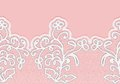 Seamless horizontal lace border with flowers. White lace on a pink background. Royalty Free Stock Photo
