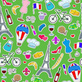 Seamless illustration on the theme of travel in the country of France, simple icons patches, the coloured symbols on a green backg Royalty Free Stock Photo