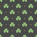 Seamless irish green pattern with clover and heart on a dark gray background Royalty Free Stock Photo
