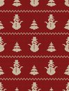 Seamless knitted pattern with Christmas trees and snowmen on a red background