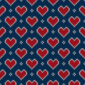 Seamless knitted pattern with hearts valentine s day background on the wool texture eps available Stock Photo