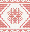 Seamless knitted pattern with red flower vector illustration Royalty Free Stock Images