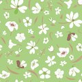 Seamless meadow vector pattern with white flowers scattered on green background