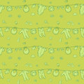 Seamless monochrome green pattern with cute baby clothes .