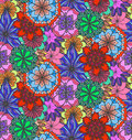 Seamless multicolored texture with doodle flowers.