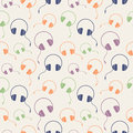 Seamless music vector pattern, chaotic background with colorful headphones Royalty Free Stock Photo