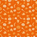 Seamless orange background with a Halloween theme. The background shows a pumpkin, a broom, a witch`s cap, a ghost and a bat.