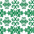 Seamless ornament pattern with green swirl elements on white Stock Image