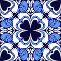 Seamless ornamental pattern on a dark blue background is presented Stock Photography