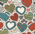 Seamless ornate pattern with hearts. Endless hand drawn cute background