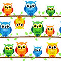 Seamless owls on tree branch Stock Photo