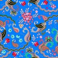 Seamless paisley floral pattern on blue background in vector. Rose, cosmos flowers,daisy and leaves and fantasy buta ornament