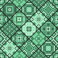 Seamless patchwork pattern from square patches in green tones. Royalty Free Stock Photo
