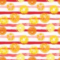 Seamless pattern with abstract slices of lemon and orange on stripes in grungy style Royalty Free Stock Photo