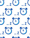 Seamless pattern with alarm clock and symbol of sleep on white background. Royalty Free Stock Photo