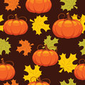 Seamless pattern of autumn leaves and pumpkins Royalty Free Stock Photo