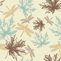 Seamless pattern of autumn, maple leaves and a dra Royalty Free Stock Photo