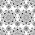 Seamless pattern background with black and white mehndi henna lace buta decoration items in Indian style. Royalty Free Stock Photo