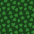 Seamless pattern background of green poker suits - hearts, clubs, spades and diamonds - on green background. Casino