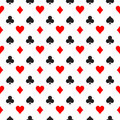 Seamless pattern background of poker suits - hearts, clubs, spades and diamonds - arranged in the rows on white
