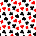 Seamless pattern background of poker suits - hearts, clubs, spades and diamonds - on white background. Casino gambling