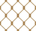 Seamless pattern, background, yellow rope woven in the form fishing net Royalty Free Stock Photo