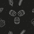 Seamless pattern of beers, ears, hop, pretzels against a black background Royalty Free Stock Photo