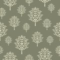 Seamless pattern with beige abstract trees on a dark khaki background