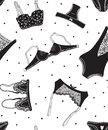 Seamless pattern of black icons of women's underwear on a white background with dots. Royalty Free Stock Photo