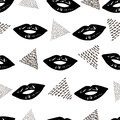 Seamless pattern with black lips and triangles