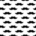 Seamless pattern with black mustaches. Vector illustration