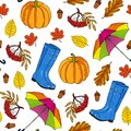 Seamless pattern from blue rubber boots, colorful umbrella and red maple leaves on a white background