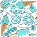 Seamless pattern with blue and white sweets.
