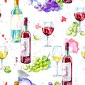 Seamless pattern of a bottle of white and red wine,grape and glasses. Royalty Free Stock Photo