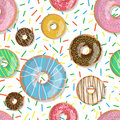 Seamless pattern bright tasty vector donuts illustration isolated on the sprinkles background. Doughnut background