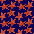 Seamless pattern with bronze stars on a blue background