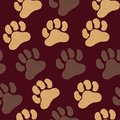 Seamless pattern with brown and beige acrylic paw prints