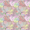 Seamless pattern with brown hearts on the background of hearts in different colors.