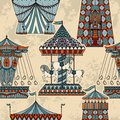 Seamless pattern with carousel and tent. Funfair theme. Royalty Free Stock Photo