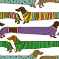 Seamless pattern with cartoon dachshund dogs funny long dressed in colorful clothes Stock Photos