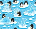 Seamless pattern with cartoon penguins create ice sculptures