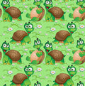 Seamless pattern with cartoon turtles on a green meadow daisies Royalty Free Stock Photo